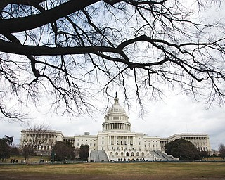 The U.S. Capitol is seen in Washington. After months of dire warnings about the across-the-board spending cuts, the $85 billion budget trigger didn't spell doom. On talk shows Sunday, neither Republicans nor Democrats hinted at a tangible proposal for rolling back those cuts, yet Republicans and Democrats have pledged to retroactively undo the cuts.