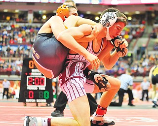 Nick Mancini of Boardman works to get Greg Brusco of Delaware off of his back during the consolation match for third place at 113 pounds in Division I of the OHSAA state wrestling tournament Saturday in Columbus. Mancini bombed Brusco, 11-0.