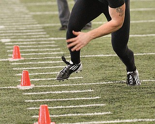 A group of 12 NFL scouts watched five Youngstown State University football players go through various drills Tuesday during YSU's NFL Pro Day at the WATTS on Tuesday.