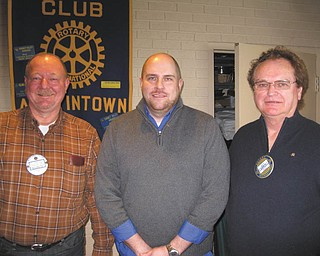 SPECIAL TO THE VINDICATOR Josh Joki, center, regional director of the Siffrin Group on Westchester Drive in Austintown, was recently inducted by Chuck Baker Jr., left, as the newest member of the Rotary Club of Austintown. On the right is Ron Carroll, president. Joki is an Austintown resident and father of five. He commented that the variety of activities done by Rotary was his inspiration for joining. In other business, long-time member Frank Santisi became the newest honorary member of the club. He is a past president and active member in many aspects of the organization.