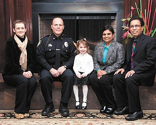 SPECIAL TO THE VINDICATOR Honorees of the seventh annual Cattle Baron's Ball planned March 23 at Antone's Banquet Center are, from left, Anna Aey, YSU Chief of Police John Beshara, Ava Timko, Dr. Lakshmi Perni and Dr. V. C. Perni.