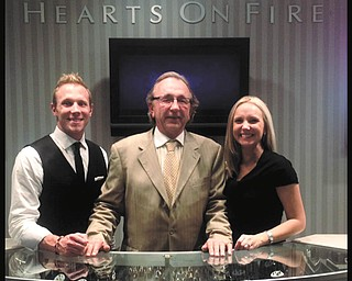 SPECIAL TO THE VINDICATOR The Komara family will be recognized for their efforts in supporting the Alzheimer's Association at the Forget-Me-Not Gala April 13 at Tippecanoe Country Club in Canfield. Pictured are Bob Komara, center, who heads Komara Jewelers, and his children, Bob Komara and Briana Komara Pridon, who are managers at local Komara stores.