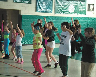 SPECIAL TO THE VINDICATOR Cold and snow is not stopping the students from moving at St. Patrick School in Hubbard. A group of students is shown participating in Zumbatonic, which the school offers every Wednesday after class. Tina Sims, certified Zumba instructor, leads the 45-minute session that is open to all students and families. The school nurse also has begun a Lunch Laps program that encourages students to walk and keep track of their progress. There also is a roller skating program for gym class two times weekly for a six-week program.