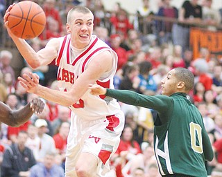 LaBrae's Peyton Aldridge (10) passes over Ursuline's Desmond McElroy (0) during the Vikings' 68-61 double-overtime win for the Division III district title Saturday at Howland. Cardinal Mooney and Youngstown Christian also advance to regional play this week in Canton after winning their districts — Division II and IV, respectively — over the weekend.