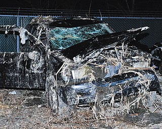 The Honda SUV in which six Warren teens were killed Sunday sits at the Ohio State Highway Patrol post in Southington.