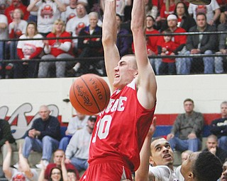 LaBrae's Peyton Aldridge (10) dunks during the Vikings' 75-52 win over the Oberlin Phoenix in the Division III regional semifinal Wednesday at Canton Memorial Fieldhouse.