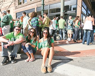 Steve Procopio, Kacy McCormick and Alexandria Hatosky of Warren enjoyed an unusually hot St. Patrick's Day in downtown Youngstown last year.