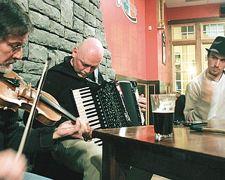 "Frank Krygowski , Mike Shaffer and John Vitullo play during an traditional Irish music jam session or ""sessiun"" at a downtown Youngstown pub."