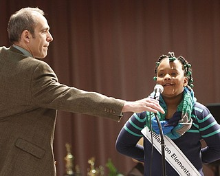 ROBERT  K.  YOSAY  | THE VINDICATOR --..Tim Roberts -  adjusts the microphone for Bryona Colyar - of 2nd grader at Williamson Elementary..The 80th  Youngstown Vindicator Spelling Bee was held at Kilcawley Center on YSU Campus  Saturday morning with  60 competitors from area schools.. ..(AP Photo/The Vindicator, Robert K. Yosay)