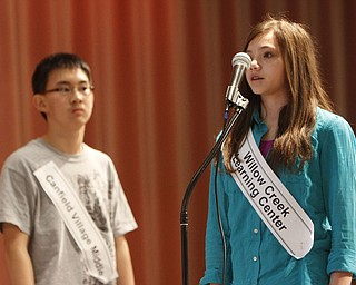 ROBERT  K.  YOSAY  | THE VINDICATOR --..Final Word -  as  Tamsin Day Willow Creek Elementary 8th grader misses the word as Max Lee Canfield Middle School --looks on..The 80th  Youngstown Vindicator Spelling Bee was held at Kilcawley Center on YSU Campus  Saturday morning with  60 competitors from area schools.. ..(AP Photo/The Vindicator, Robert K. Yosay)