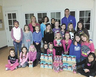 SPECIAL TO THE VINDICATOR Girl Scout Troops 80183 and 80322 from Poland recently donated more than five dozen boxes of Girl Scout Cookies from the fall sale to St. Vincent de Paul Society food pantry. The troops are shown with their leader Shelly DiFabio, in back, who presented the cookies to Brian J. Antal, president of St. Vincent de Paul Society. The troops are planning other service projects for St. Vincent de Paul throughout the year.