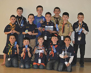 Cub Scout Pack 4050 from Cortland recently held its annual Pinewood Derby at the Optimist Club's Candlelite Knolls. Forty-six Scouts from 5 to 12 years old participated. The top three racers from each den advance to the Pack 4050 Championship Pinewood Derby April 27 at Eastwood Mall in Niles. Each pack in the Arrowhead District is invited to send the top three racers from each of their Dens to compete in the championship. For information visit Pack 4050.com. Pictured are Cub Scout 4050 Den winners, kneeling from left, Dakota Tolley, Wolves Den, second place; Gavin Dodrill, Tigers Den, second place; Sam Harper, Tigers, first place; Adien Johnson, Tigers, third place; and Cade Cratsley, Bears Den, third place; in the middle row are Nathan Driscoll, Wolves, third place; Evan Lenox, Bears, first place; Hunter Picuri, Webelos 1, first place; Ian Garcia, Webelos I, third place;  and Evan Davies, Bears, second place; in back are Nathan Woofter, Webelos II, second place; Ethan Toot, Webelos II, first place; and Jon Grimm, Webelos I, second place. Pack winners, below, are Derek Sandor, left, third place; Hunter Picuri, first place; and Ian Garcia, second place; with their leaders, Tim Grimm and Tim Sandor.