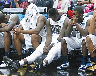 Pittsburgh players watch from the bench during the final minutes of their game against Wichita State during Round 2 of the NCAA basketball tournament Thursday in Salt Lake City. The No. 8 Panthers were eliminated by the ninth-seeded Shockers, 73-55.