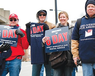 Local United States Postal Service employees demonstrate at the main post office in downtown Youngstown to have Congress overrule a U.S. Postal Service decision to end Saturday mail delivery.