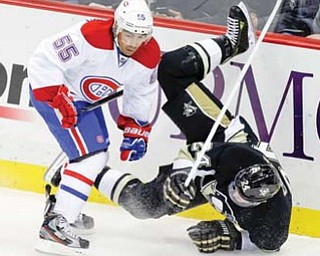 Montreal Canadiens defenseman Francis Bouillon (55) collides with Pittsburgh Penguins left wing Matt Cooke (24) in the fi rst period of an NHL hockey game in Pittsburgh on Tuesday.