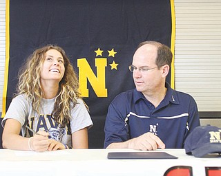 Canfield's Allison Pavlansky signs a letter of intent to attend the U.S. Naval Academy as her father and the team's coach, Pat Pavlansky, watches during a ceremony Thursday at Canfield High School. Pavlansky will play tennis for the Midshipmen. A four-time most valuable player for the Cardinals, she is the reigning two-time All-American Conference player of the year and helped the Cardinals to four consecutive American Division crowns.