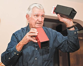 Bob Filips shows off some of his magic tricks. He has belonged to the Youngstown Magic Club since he was 15.