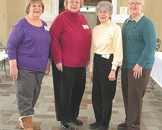 """Members of the Women's Committee for Children's Concerts are making final preparations for the April 11 event at Edward W. Powers Auditorium in Youngstown. From left are Carol Fithian, Lois Klein, Judy Graziano and Jan Szalma. Concerts will be at 9:30 and 11:30 a.m. Students in first through eighth grades will travel through the solar system by sight and sound. The """"Final Frontier"""" selections will include music from """"Star Wars,"""" """"ET"""" and Holst's """"The Planets."""" Dr. Jose Francisco Salgado will present a narrative on the Hubble telescope images of the galaxy. Students will have the opportunity to meet Dr. Randy Fleischer, conductor of the Youngstown Symphony Orchestra.   NICK MAYS 