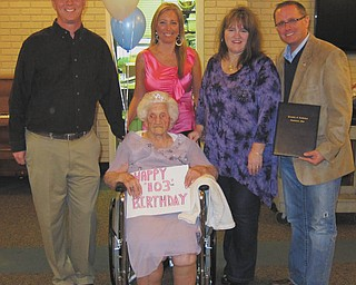 """SPECIAL TO THE VINDICATOR Austinwood Nursing Facility in Austintown was the location of the 103rd birthday party for Pearl Walters, seated, who was born March 26, 1910. Wearing a tiara and purple studded dress, Walters was presented with a proclamation from Austintown elected officials. From left they are the Rev. Rick Stauffer and Lisa Oles, trustees; Laurie Wolfe, fiscal officer; and Jim Davis, trustee. She has six children, 19 grandchildren, 22 great-grandchildren and 13 great-great-grandchildren. She played the harmonica and piano. Her favorite color is pink, her favorite holiday is Easter and her favorite song is """"When the Work Is All Done This Fall."""""""