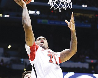 Louisville's Chane Behanan (21) lays the ball up during the first half of the Midwest Regional final against Duke in the NCAA college basketball tournament Sunday in Indianapolis.