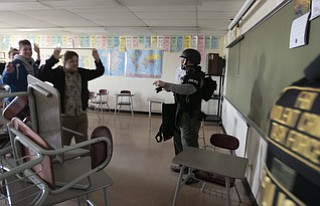 ROBERT K. YOSAY  | THE VINDICATOR..Officers empty a classroom after student barricaded themselves in the room - ..BPD and area law enforcement had a mock drill of a shooter at Boardman High School - .. - -30-..