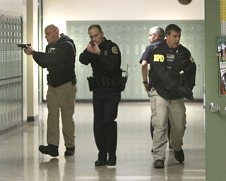 ROBERT K. YOSAY  | THE VINDICATOR..Clearing a hallway  Ptl Glen Patton - Ptl Rob Spector Det jack Neappolitan and Det Greg Stepak -  a;ll BPD ..BPD and area law enforcement had a mock drill of a shooter at Boardman High School - .. - -30-..