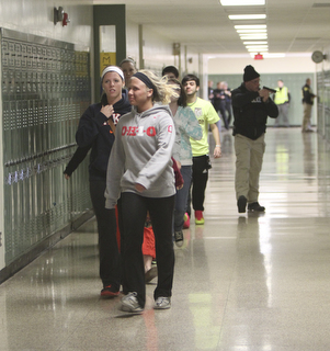 ROBERT K. YOSAY  | THE VINDICATOR..Students are escorted out of the building  after the  two intruders had been apprehended.. but still under the watchful eye of the force - BPD and area law enforcement had a mock drill of a shooter at Boardman High School - .. - -30-..