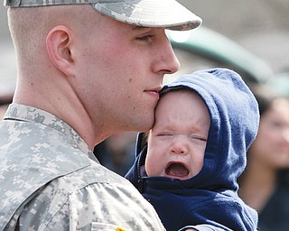 Pvt. Brandon Brown, with the 838th Military Police Co., shares a moment with his son Brandon Tyler Brown,