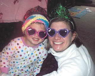 Aaliyah Considine and her mom, Emily Considine, practice being princesses. They live in Columbus. Photo sent in by Grandmother Chris Considine of Poland.