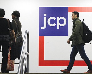 Customers arrive at a J.C. Penney store Tuesday in New York. J.C. Penney is hoping its former CEO can revive the retailer after a risky turnaround strategy backfired.