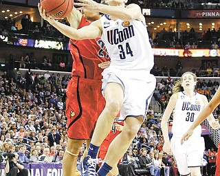 Connecticut guard Kelly Faris (34) goes up for a shot against Louisville guard Bria Smith during the second half of the NCAA women's national championship game in New Orleans on Tuesday.