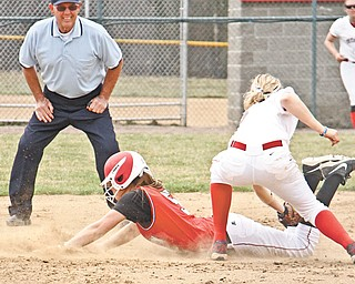 Youngstown State's Kelly Stowe (5) slides into second base, beating the tag by Detroit's Kayla Kostich (5), during the fourth inning of Wednesday's matchup at McCune Park in Canfield.