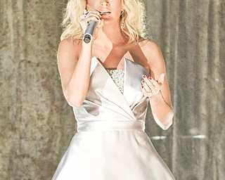 Carrie Underwood performs on stage at the 55th annual Grammy Awards on Sunday, Feb. 10, 2013, in Los Angeles.