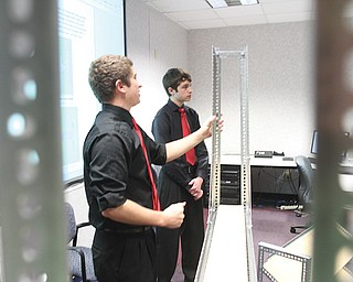 Youngstown State University engineering students Brandon O'Neill, left, of Lordstown, and Kyle Spickler of Columbiana, show scaffolding they designed as part of a contest with Hynes Industries of Austintown.