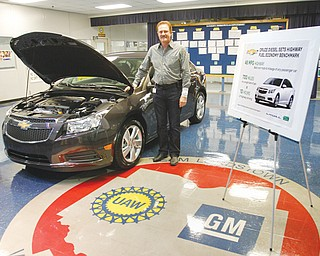 Gary Altman, chief engineer of Chevrolet's 2014 Cruze Clean Turbo Diesel, stands with one of the models at GM Lordstown on Thursday. The model will begin arriving at major metropolitan dealerships in May and others across the country and in Canada by this fall.