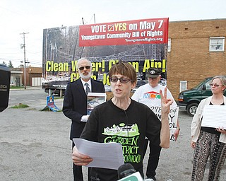 Supporters of an anti-fracking charter amendment on Youngstown's May 7 ballot unveil billboards. Lynn Anderson, front, spoke Thursday in support of the amendment. Behind her, from left, are Tom Cvetkovich, Jack Slanina and Susie Beiersdorfer. This billboard is on South Avenue.