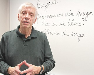 Ron Saffell talks about the conversational French course he teaches at Youngstown State University's Metro College in Boardman. Spanish, Italian and Arabic also are taught at the Southwoods Commons location.