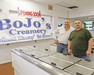John Evan and Bob McAllister stand inside their newest BoJo's Creamery store on Market Street in Boardman. The business partners plan to open the shop late this month.