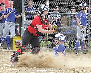 Poland's Taylor Miokovic is out at the plate on a force play as Canfield catcher Amelia Manenti takes the throw during a game Tuesday. Canfield won, 4-3, on Kayley Keller's walk-off home run in the seventh inning.