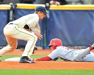 Youngstown State's Phil Lipari slides into third base, beating the tag of Kent State's Justin Wagler during the second game of a doubleheader Tuesday.