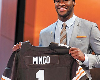Louisiana State defensive end Barkevious Mingo holds up his team jersey after being selected sixth overall by the Cleveland Browns during the first round of the NFL draft on Thursday at Radio City Music Hall in New York.