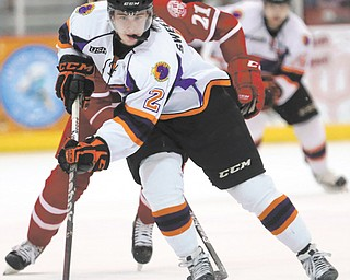 The Phantoms' Eric Sweetman breaks away from John Stevens of the Fighting Saints during Game 1 of the USHL Eastern Conference final on Friday at the Mystique Community Ice Center in Dubuque, Iowa. Youngstown thought it scored late in Saturday's Game 2, but the goal light did not go on in the 3-1 loss.