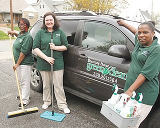 Three owners of Beatitude House Green Clean, a co-op company, stand next to one of the vehicles used by the business. They are, from left, Remona Gordon, Joyce Koellner and Rose Mary Seals.