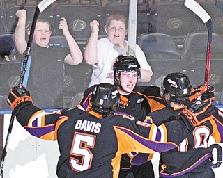Phantoms defenseman Eric Sweetman, center, celebrates with teammates Tommy Davis and Josh Nenadal after scoring a first-period goal in Tuesday's playoff win over Dubuque at the Covelli Centre.