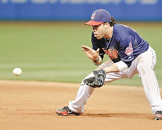 Cleveland Indians' Jason Kipnis fields a ball hit by Philadelphia Phillies' Ben Revere during the seventh inning of a baseball game, Tuesday in Cleveland. Revere grounded into a double play.