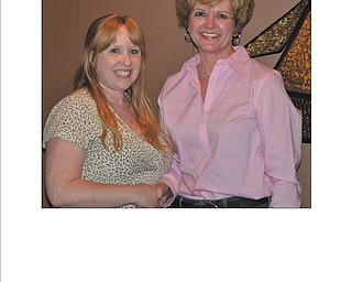 SPECIAL TO THE VINDICATOR Amy Miller, left, was inducted into the Columbiana Area Business and Professional Women on April 23 and was  welcomed into membership by Jenny Pike, CABPW president. The event was at Mason's Steak House in Washingtonville. Miller, with her husband, Mike, owns and operates the Coin Shop in Struthers. They also buy and sell precious metals and operate a high-end specialty garlic farm. If interested in joining CABPW, call Lori Everly at 330-853-5896 or email leverly1101@aol.com; attend a meeting or visit it on Facebook. Membership dues are $43 per year.