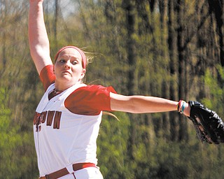 YSU's Hana Somogyi winds up on the mound during the first game of a doubleheader against St. Bonaventure on Wednesday at McCune Park in Canfield. The Penguins downed the Bonnies, 7-1, but lost the nightcap, 7-4.