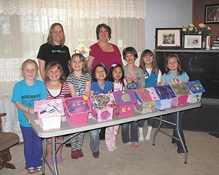 SPECIAL TO THE VINDICATOR The eight girls of Daisy Girl Scout Troop 80777 of Columbiana participated in building and decorating earth-friendly birdhouses at the April meeting. The girls learned about reducing, reusing and recycling over the past few months and have earned all the petals of their Daisy Flower Badge set. The birdhouses are made of recycled newsprint. They will be displayed today and tomorrow at Springtime in Columbiana for a contest. Showing off their work are, from left in the front row, Rebekah Clark, Abbie Passmore, Elizabeth Siembida, Mia Surgenivic, Chloe Gill, Airianna Scullion, Alaina Johnston and Katrina Kaszowski. In the back row are Crystal Siembida Boggs, troop leader, and Kathy Kaszowski, troop co-leader.