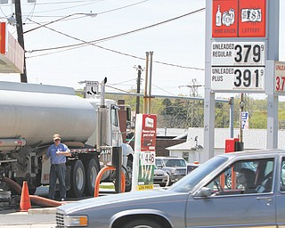 A fuel truck delivers gas to a station on Mahoning Avenue in Austintown. Drivers have seen gas prices go up