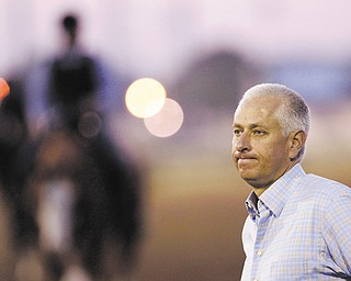 Trainer Todd Pletcher watches the morning workouts at Churchill Downs in Louisville, Ky. On Saturday, Pletcher has a plethora of contenders in the 139th Kentucky Derby, including Verrazano and Revolutionary.